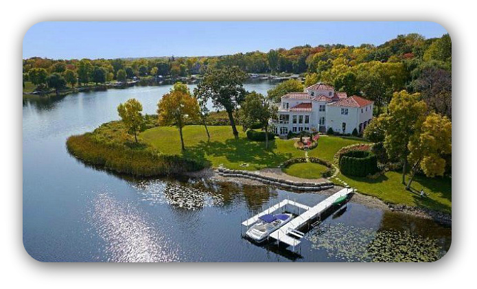 a waterfront home with a boat dock