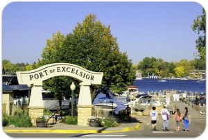 excelsior sign with lake in background