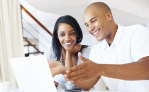 couple looking at laptop happily