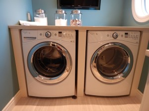 a high end washer and dryer set up in a dedicated laundry room