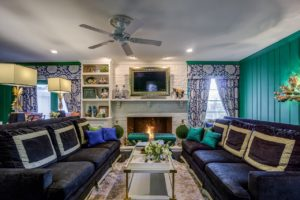Beautiful living room interior with teal walls.